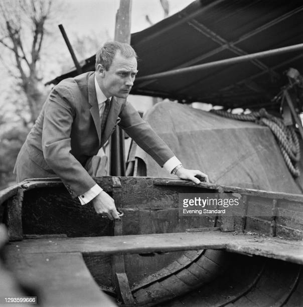 English actor Edward Woodward with an old rowing boat, UK, May 1967.
