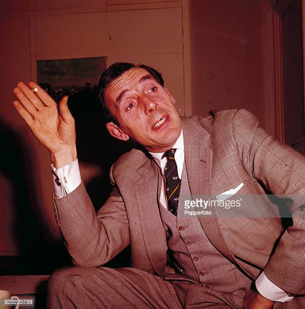 English actor Eric Sykes pictured wearing a three piece suit in 1964
