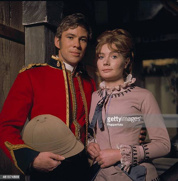 English actor Gary Bond pictured wearing military uniform with British actress Ann Bell in a scene from the television series 'Frontier - Duel of...