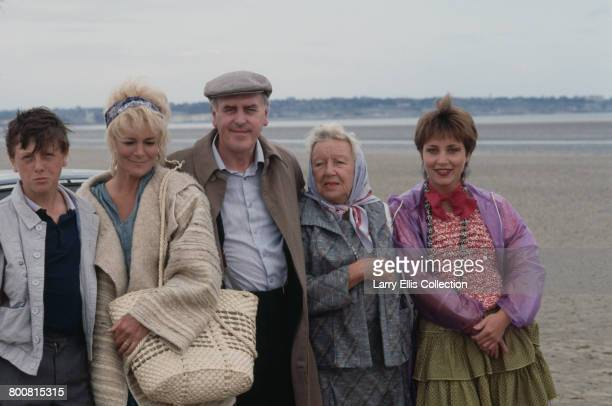 English actor George Cole pictured in centre in character as Reg Dudgeon with fellow actors from left David Garlick Barbara Ewing Doris Hare and...