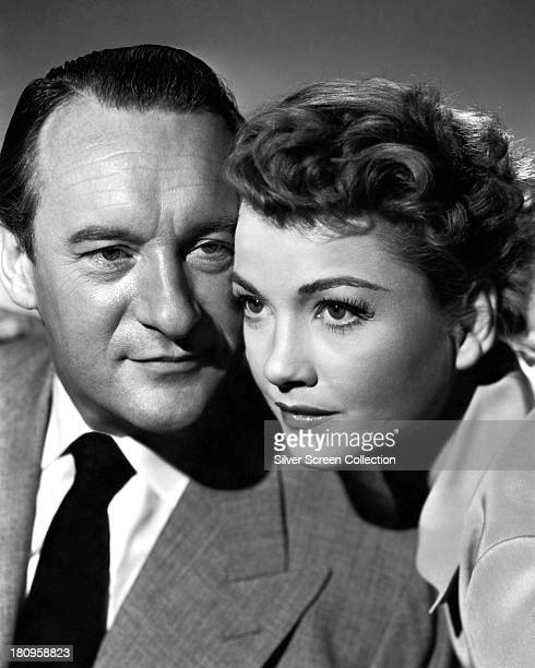 English actor George Sanders and American actress Anne Baxter in a promotional portrait for 'All About Eve' directed by Joseph L Mankiewicz 1950