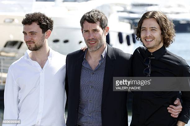 English actor Georges Blagden French director Jalil Lespert and Welsh actor Alexander Vlahos pose during a photocall for the series Versailles during...