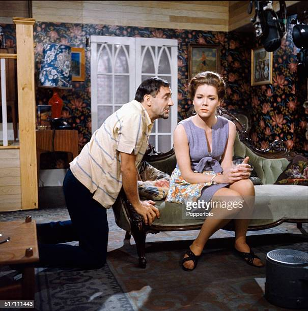 English actor Harry H Corbett pictured with actress Diana Rigg in a scene from the television drama 'The Hot House' in 1964