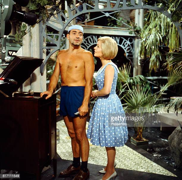 English actor Harry H Corbett pictured with actress Miranda Connell in a scene from the television drama 'The Hot House' in 1964