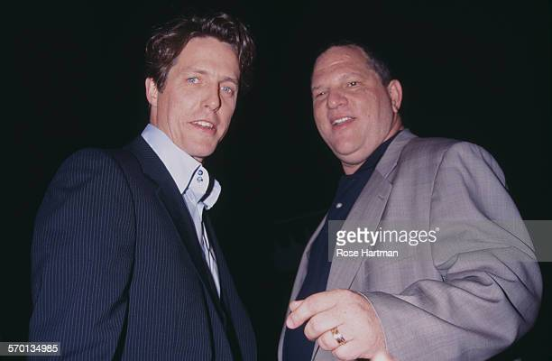 English actor Hugh Grant and American film producer Harvey Weinstein attend the 'Talk' magazine party Battery Park New York City USA circa 1999
