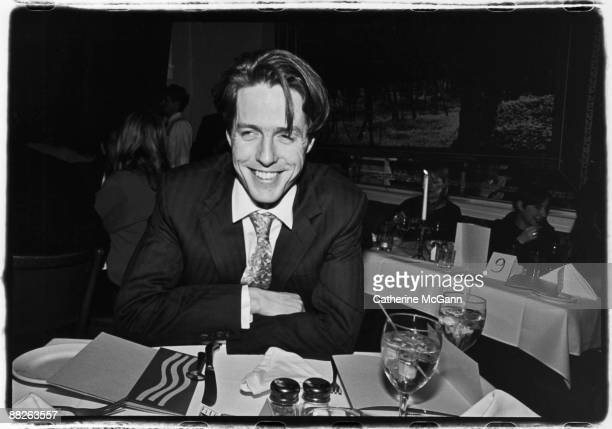 "English actor Hugh Grant poses for a photo at a party for his film ""Sirens"" in 1994 in New York City, NY."