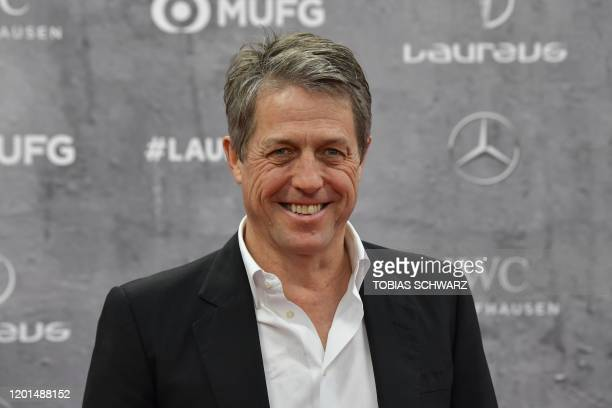 English actor Hugh Grant poses on the red carpet prior to the 2020 Laureus World Sports Awards ceremony in Berlin on February 17, 2020.