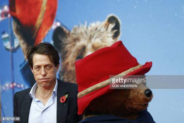 English actor Hugh Grant reacts during a red carpet event for the German premiere of the movie Paddington 2 in Berlin on November 12 2017 / AFP PHOTO...