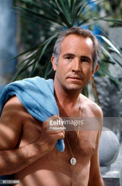 English actor Ian Hendry pictured bare chested on the set of the television drama series 'Armchair Theatre A Cold Peace' in 1965