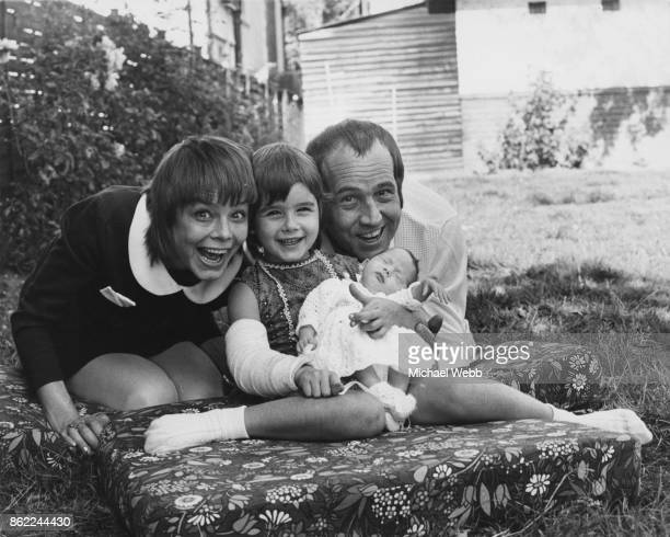English actor Ian Hendry with his wife actress Janet Munro their 6yearold daughter Sally and their new baby daughter Alexandra Corrie in the garden...
