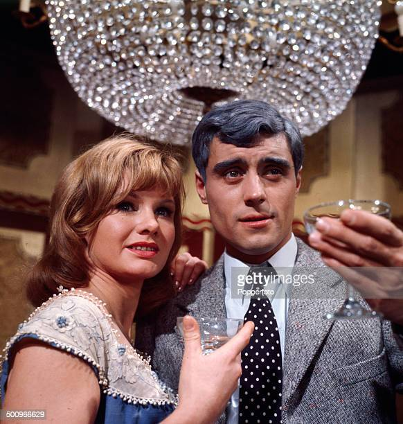 English actor Ian McShane pictured with the actress Jennie Linden in a scene from the television drama 'You Can't Win' in 1966