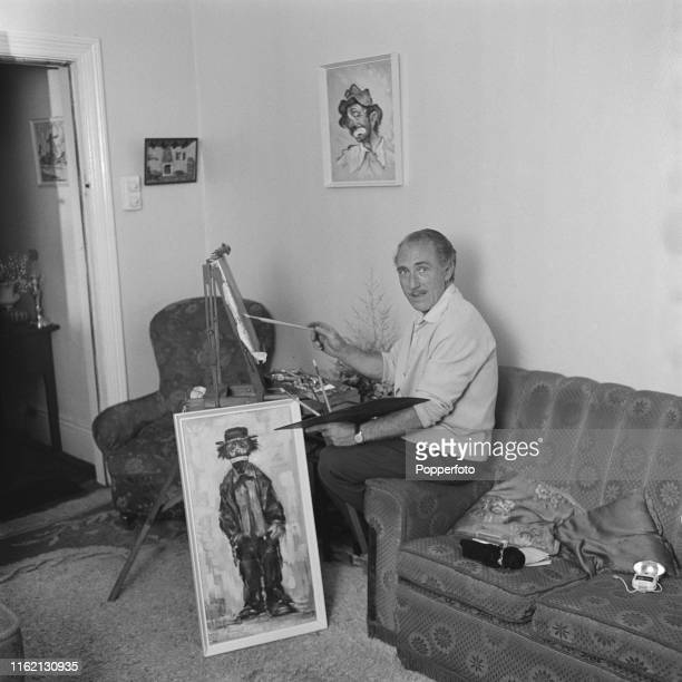 English actor Jack Haig pictured painting at an artist's easel at home in September 1965.