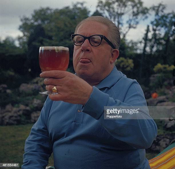 1968 English actor Jack Howarth known for his role as Albert Tatlock in the long running television soap opera 'Coronation Street' posed with a glass...
