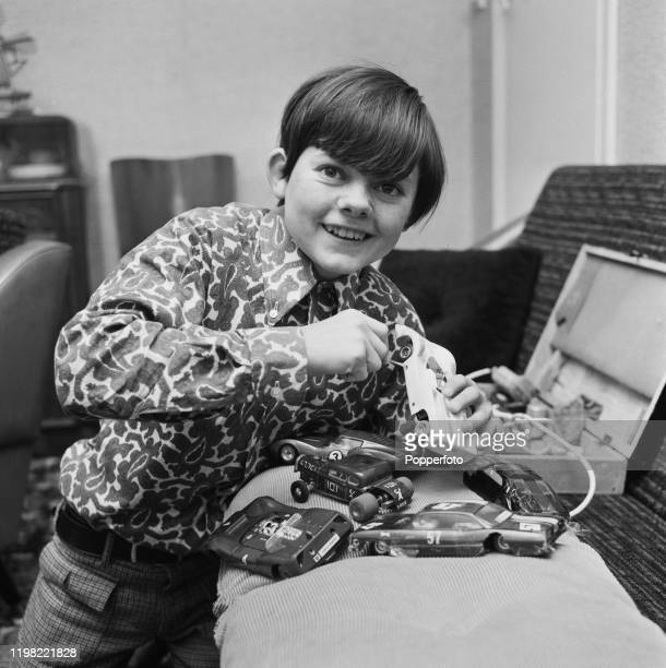 English actor Jack Wild plays with cars from a slotcar racing set in August 1968