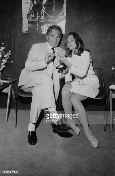 English actor James Mason with Franco-American Leslie Caron, who is looking at the British Film Institute's Alexander Korda Star award that Mason...