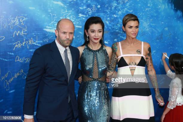 English actor Jason Statham actress Li Bingbing and Australian actress Ruby Rose attend the premiere of film 'The Meg' on August 2 2018 in Beijing...