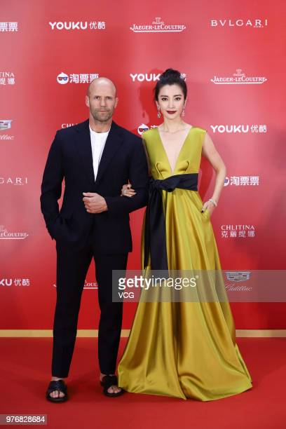 English actor Jason Statham and Chinese actress Li Bingbing arrive at red carpet during the opening ceremony of the 21st Shanghai International Film...