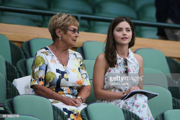English actor Jenna Coleman takes their seat in the Royal box on Centre Court to watch US player John Isner play South Africa's Kevin Anderson during...