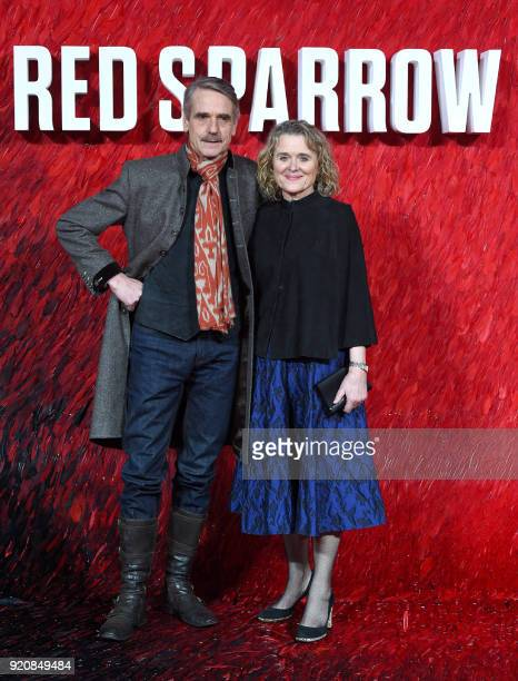 English actor Jeremy Irons and Irish actress Sinead Cusack pose on the red carpet on arrival to attend the European premiere of the film Red Sparrow...