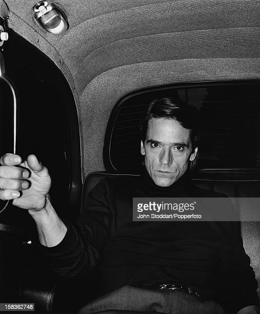 English actor Jeremy Irons in the back of a taxi 2000