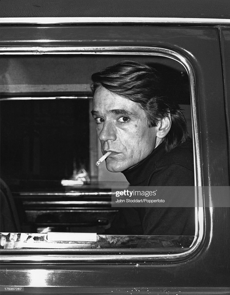 English actor Jeremy Irons in the back of a taxi, 2000.