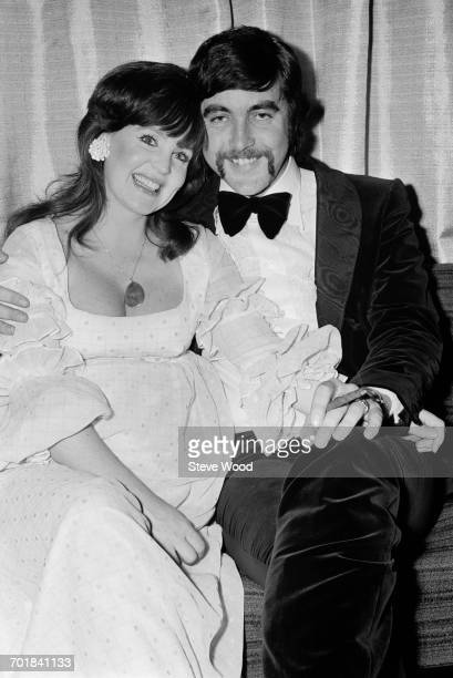 English actor John Alderton and his wife actress Pauline Collins at the opening of film 'Please Sir' London UK 18th November 1971 Alderton stars in...