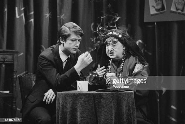 English actor John Hurt pictured with Irish actress Gladys Henson in a fortune telling scene from the ITV Play of the Week 'Finders Keepers' in March...