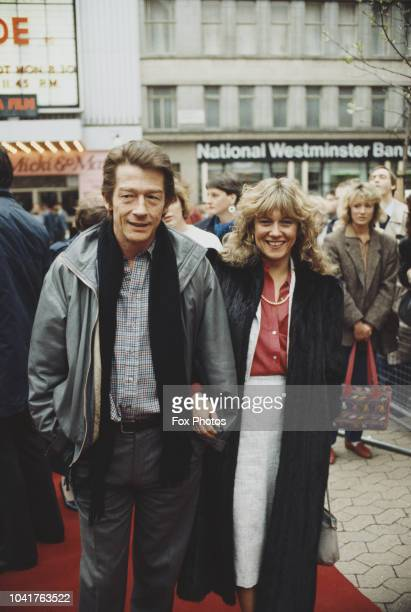 English actor John Hurt with his wife Donna at a film premiere, May 1985.