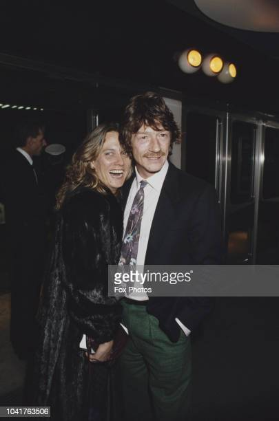 English actor John Hurt with his wife Donna at a gala performance of the film' Plenty', 21st November 1985.