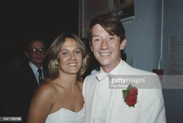 English actor John Hurt with his wife Donna at the premiere of the film 'The Hit', 1984. Hurt stars in the film, which was directed by Stephen Frears.