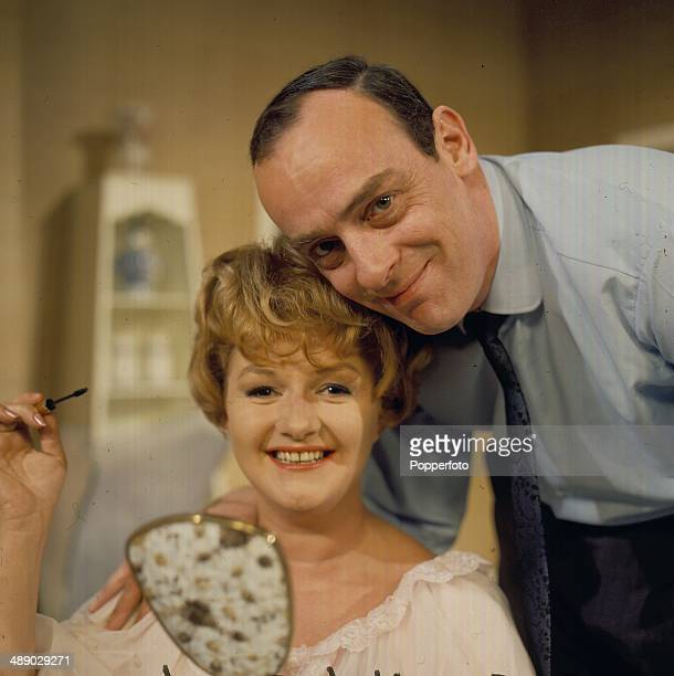 English actor John Junkin pictured with actress Joan Sims on the set of the television drama 'Sam And Janet' in 1967