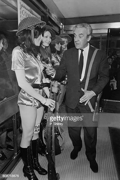 English actor John Le Mesurier with actresses Jean Kittle and Joanna Scott at the premiere of 'Dad's Army' London UK 14th March 1971