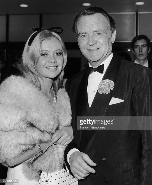 English actor John Mills escorts his daughter Hayley to the premiere of his latest film 'King Rat' at London's Columbia Theatre 3rd December 1965