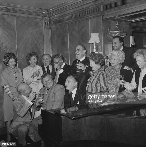 English actor John Mills with his wife English actress and author Mary Hayley Bell and friends including actors Robert Morley and Harry Secombe at a...
