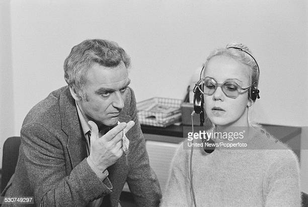English actor John Thaw on left pictured in character as Detective Inspector Jack Regan with actress Georgina Hale playing a telephonist during...