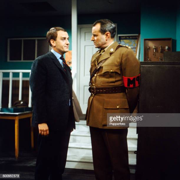 English actor John Thaw pictured on left with actor Michael Goodliffe in a scene from the television drama series 'Redcap Information Received' in...