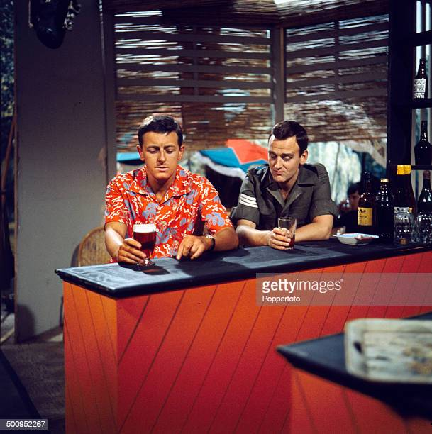 English actor John Thaw pictured on right with the actor Christopher Coll in a bar room scene from the television drama series 'Redcap Ambush Among...