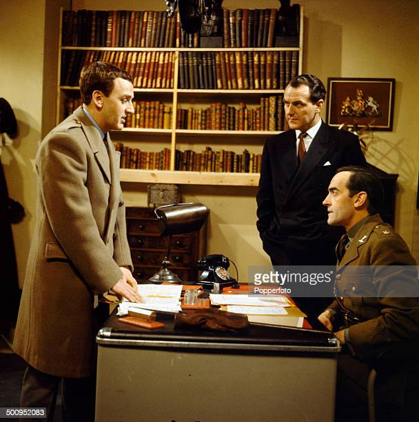 English actor John Thaw pictured standing on left with the actors Anthony Dawes and John ForbesRobertson in a scene from the television drama series...