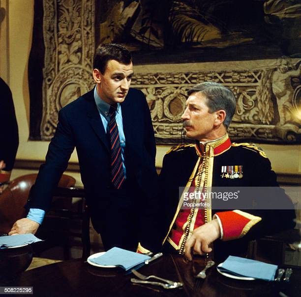 English actor John Thaw pictured with actor Terence Longdon in a scene from the television drama series 'Redcap A Question of Initiative' in 1966