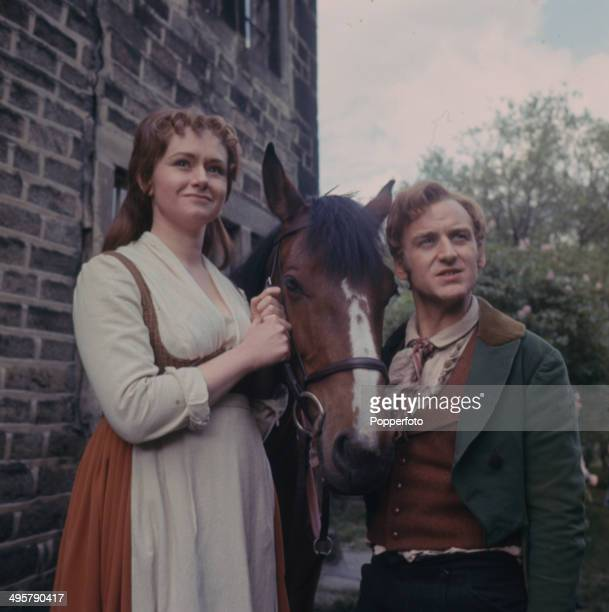 English actor John Thaw pictured with the actress Thelma Whiteley wearing period costume on location during filming of the television drama series...