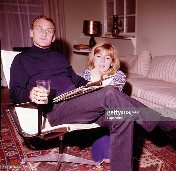 English actor John Thaw posed sitting in a lounge chair beside a young woman in 1964