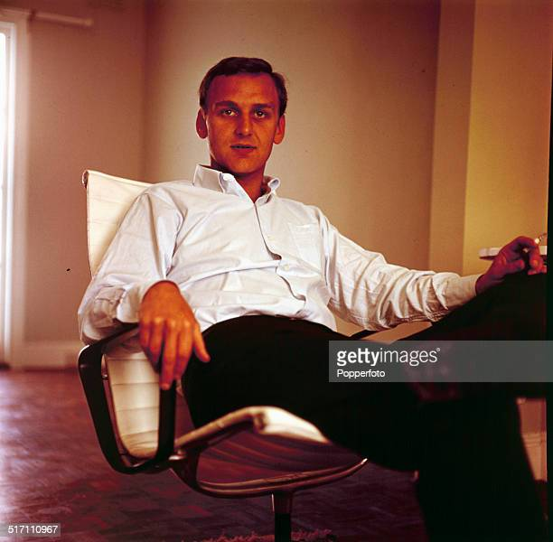 English actor John Thaw posed sitting in a lounge chair in 1964