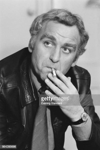 English actor John Thaw smoking a cigarette UK 1st December 1977