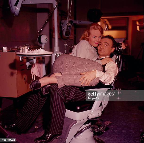 English actor Kenneth Connor pictured with the actress Shirley Eaton on the set of the television drama 'The Dentist' in 1968