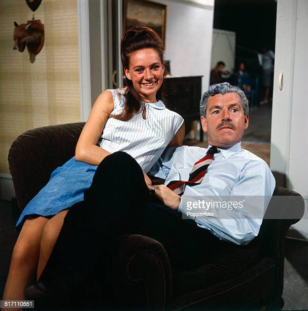 English actor Kenneth More pictured with actress Francesca Annis on the set of the television drama 'Armchair Theatre Old Soldiers' in 1964