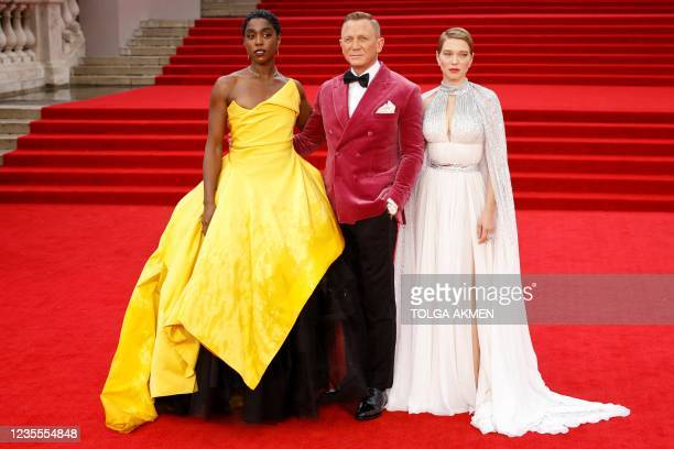 English actor Lashana Lynch , English actor Daniel Craig and French actor Lea Seydoux pose on the red carpet after arriving to attend the World...