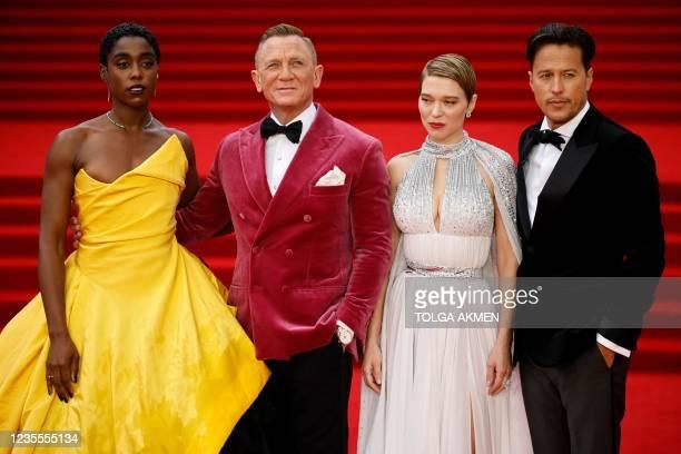 English actor Lashana Lynch , English actor Daniel Craig and French actor Lea Seydoux and US film director Cary Joji Fukunaga pose on the red carpet...