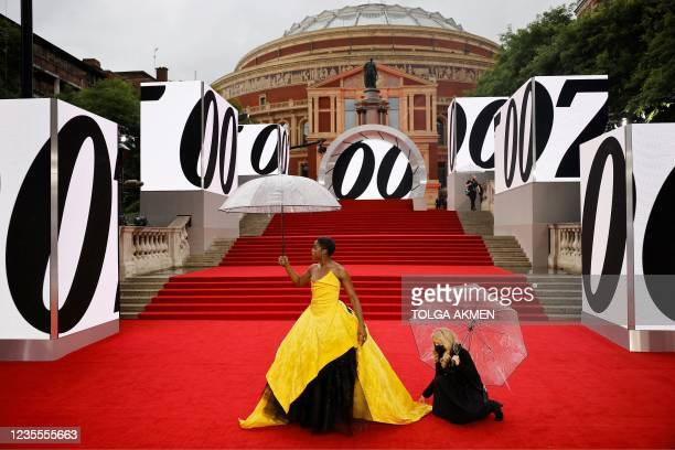 """English actor Lashana Lynch poses on the red carpet after arriving to attend the World Premiere of the James Bond 007 film """"No Time to Die"""" at the..."""