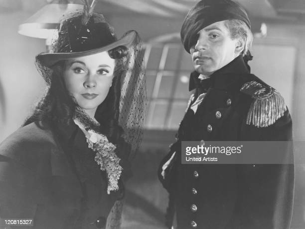 English actor Laurence Olivier and his wife Vivien Leigh as Horatio Nelson and Emma Hamilton in a scene from 'That Hamilton Woman' directed by...