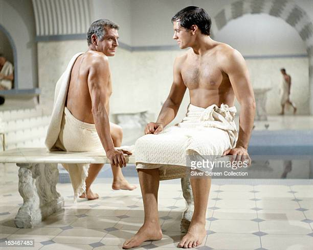 English actor Laurence Olivier as Crassus and American actor John Gavin as Julius Caesar in a bath scene in 'Spartacus' directed by Stanley Kubrick...